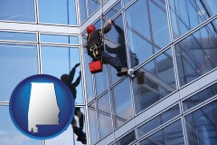 alabama map icon and a window washer, washing office building windows