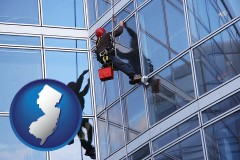 new-jersey map icon and a window washer, washing office building windows