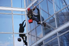 a window washer, washing office building windows