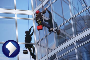 a window washer, washing office building windows - with Washington, DC icon
