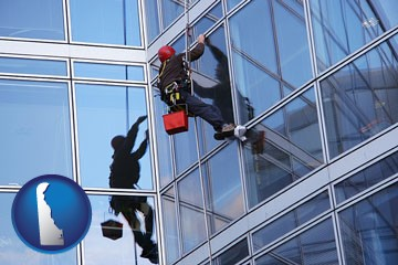 a window washer, washing office building windows - with Delaware icon
