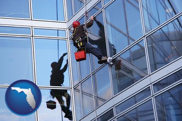 a window washer, washing office building windows - with Florida icon