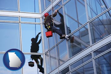 a window washer, washing office building windows - with Georgia icon