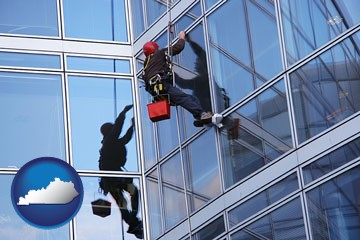 a window washer, washing office building windows - with Kentucky icon