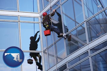 a window washer, washing office building windows - with Maryland icon