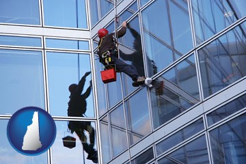 a window washer, washing office building windows - with New Hampshire icon