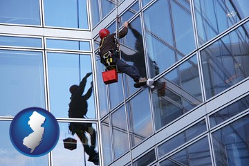 a window washer, washing office building windows - with New Jersey icon