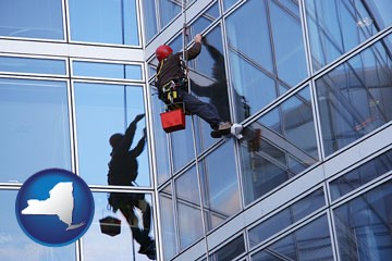 a window washer, washing office building windows - with New York icon