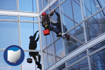 a window washer, washing office building windows - with Ohio icon