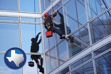 a window washer, washing office building windows - with Texas icon