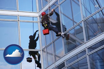 a window washer, washing office building windows - with Virginia icon