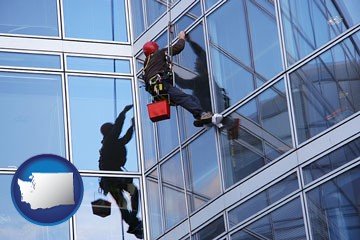 a window washer, washing office building windows - with Washington icon