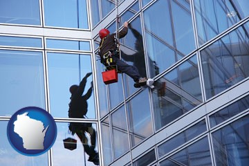 a window washer, washing office building windows - with Wisconsin icon
