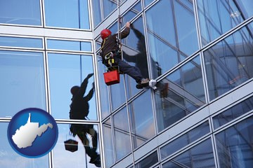 a window washer, washing office building windows - with West Virginia icon